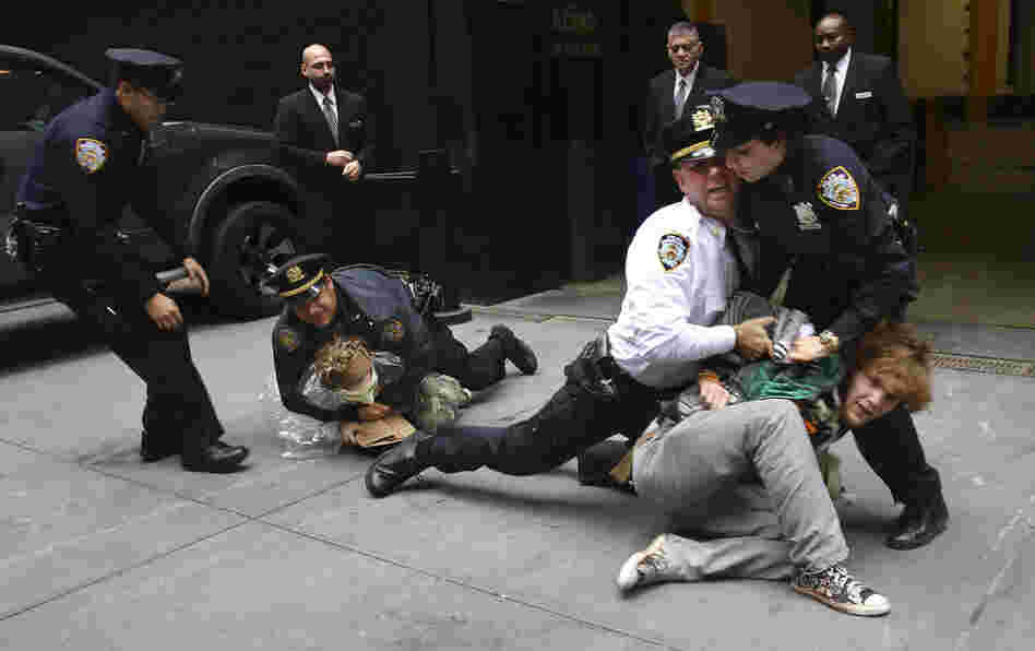 Occupy Wall Street protesters are arrested Wednesday during a march near One Chase Manhattan Plaza in New York. The protest is now in its fourth week.