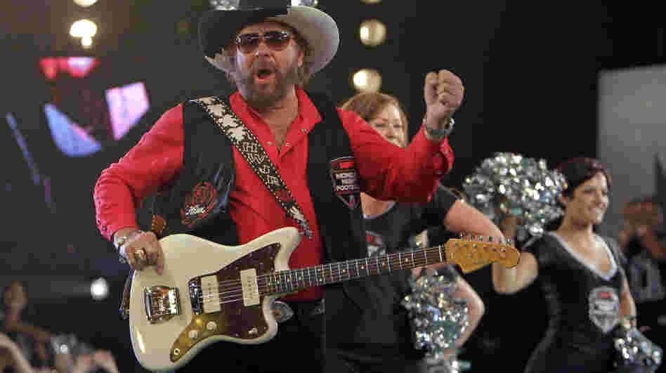 Hank Williams Jr., here seen promoting Monday Night Football, will not be part of tonight's broadcast after he made comments comparing President Obama to Hitler.