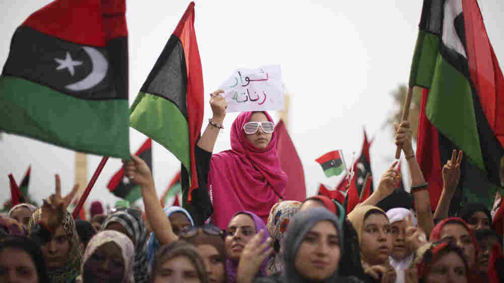 In Tripoli, Libya, women celebrate the revolution against Moammar Gadhafi's regime and call for a strengthening of women's rights, Sept. 2. After playing large but largely unsung roles during the uprising, women are now seeking a greater political role.
