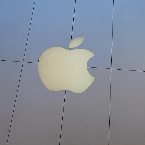 A pedestrian walks by an Apple Store in San Francisco, California.