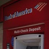 A man walks up to an ATM outside a Bank of America branch in Los Angeles. Bank of America has said it will charge customers a $5 monthly fee to use its debit card — a plan that has set off grumbling from consumer advocates at the highest levels.