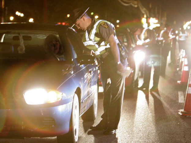 Ohio State Highway Patrol troopers talk with motorists at a sobriety checkpoint in 2006, the year CDC says drunk driving peaked.