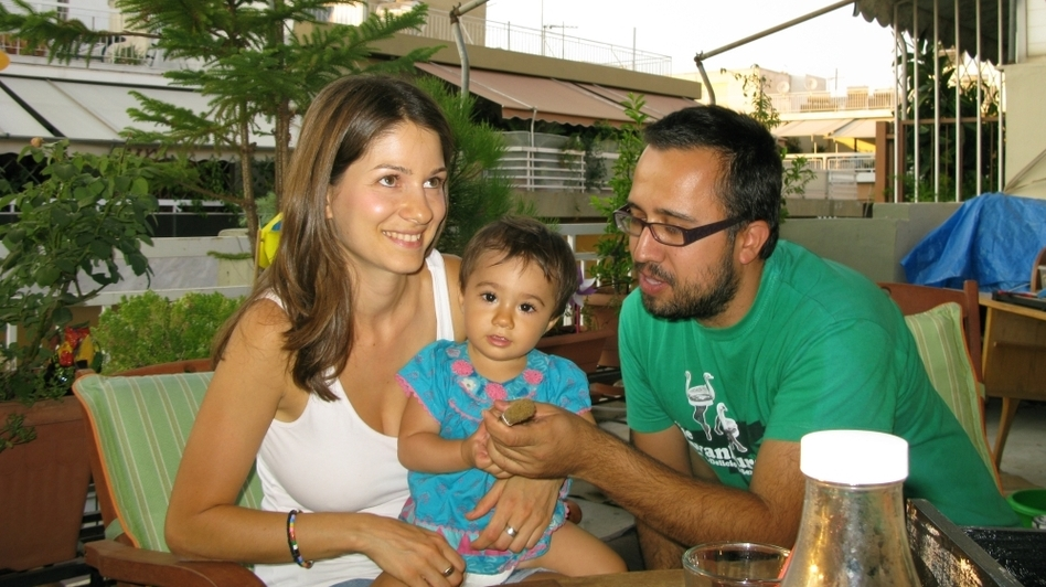 Stella Kasdagli, 30, and her husband Alexandros Karamalikis, 35, are trying to make ends meet. Karamalikis lost his job and and is now a stay-at-home father, raising their 13-month-old daughter (NPR)