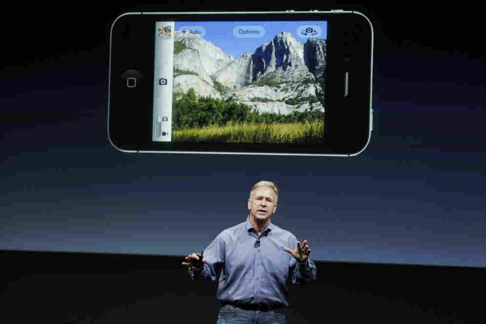 Apple marketing executive Phil Schiller describes the new iPhone 4S's camera, which includes 1080p HD video, at Apple headquarters in Cupertino, Calif.