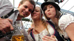 Revelers clink their beer mugs inside a beer tent on the last day of Oktoberfest in Munich. The festival drew some 6.9 million visitors this year.