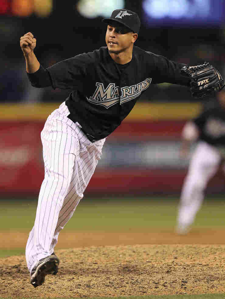Juan Carlos Oviedo, seen here closing a game for the Marlins under the name Leo Nunez, remains in the Dominican Republic after admitting falsifying documents.