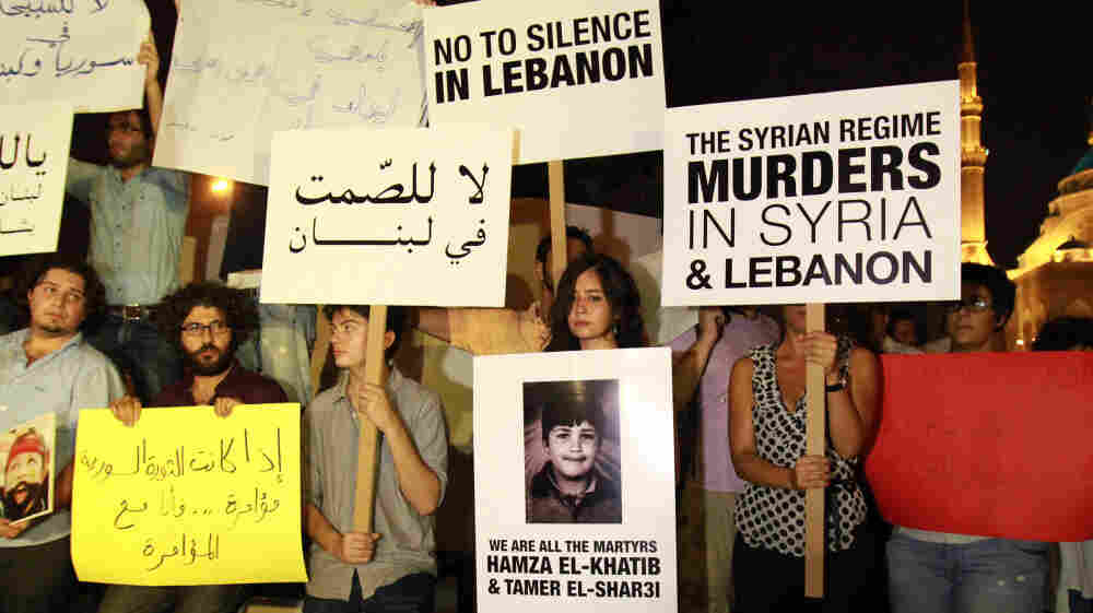 Lebanese and Syrian protesters demonstrate against the Syrian government in Beirut in August. Syrian defectors say they fear the Syrian regime will track them down, even in Lebanon.