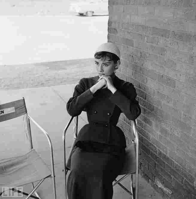 Givenchy and Hepburn met in 1953, during the making of Sabrina, and became close friends and collaborators. Pictured here is Hepburn in Givenchy on movie set.