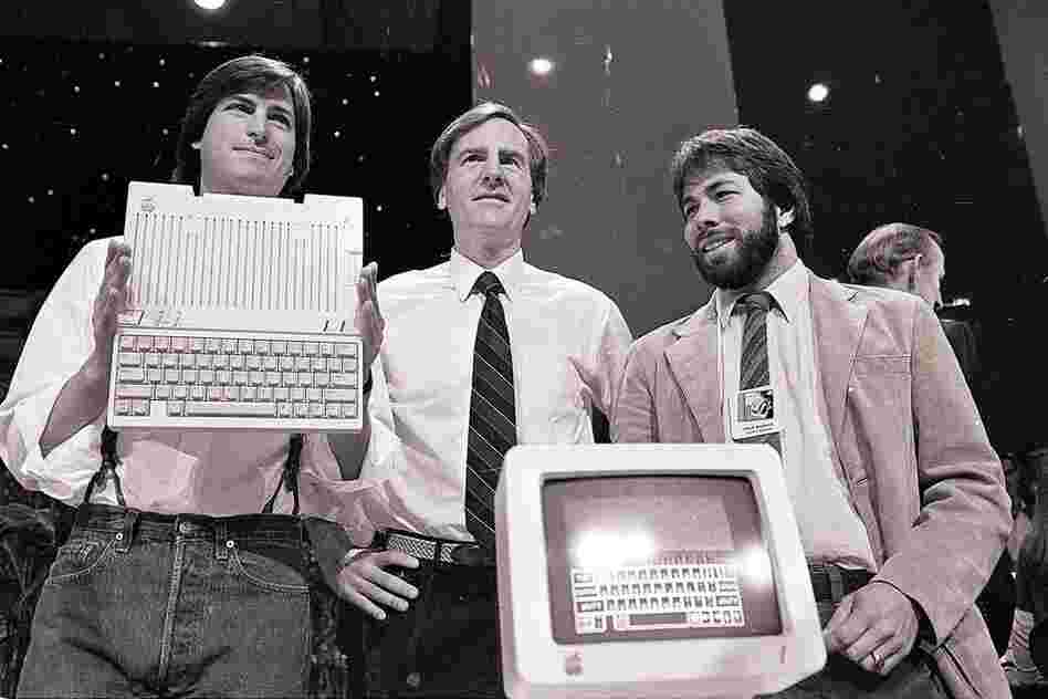 Jobs (left) with John Sculley (center) and Steve Wozniak, co-founder of Apple, unveil the new Apple IIc computer in San Francisco, 1984.