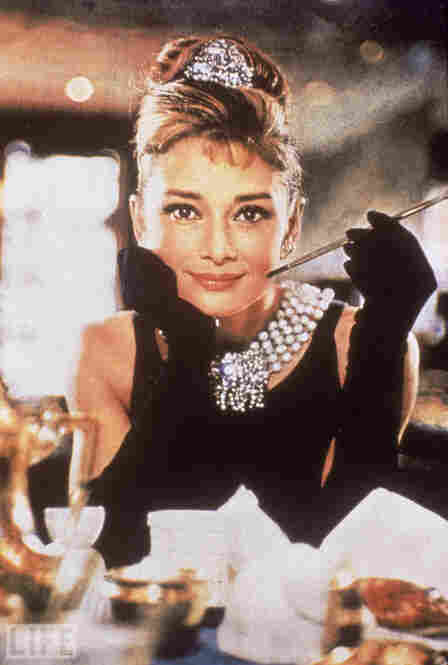 "Audrey Hepburn wears the iconic Givenchy dress in ""Breakfast At Tiffany's."""