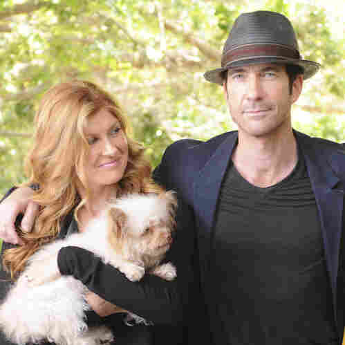 Connie Britton as Vivien Harmon, Dylan McDermott as Ben Harmon, Taissa Farmiga as Violet Harmon in American Horror Story.