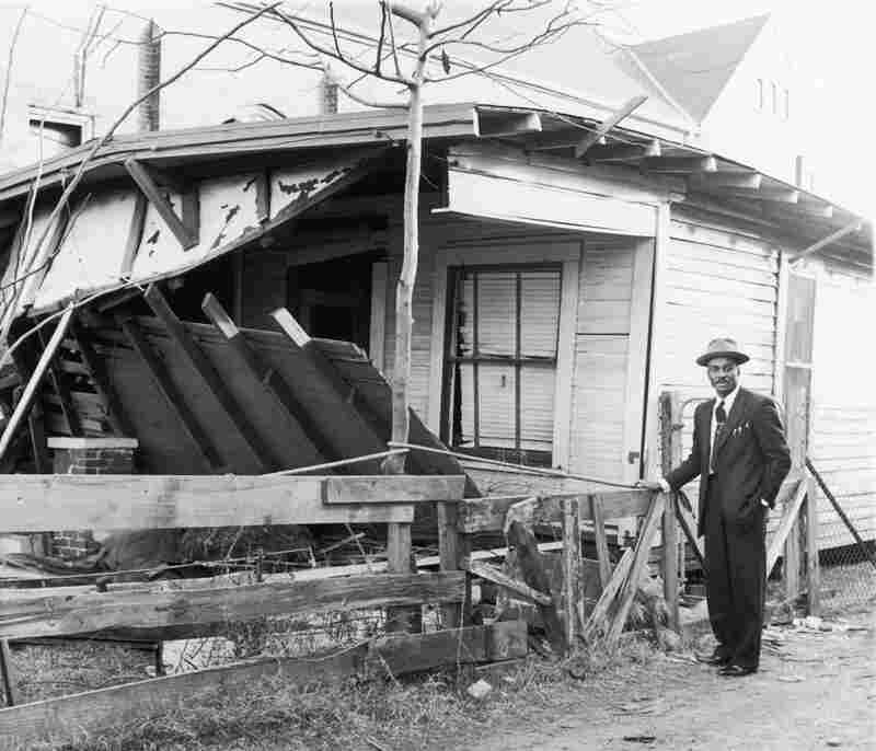 In this undated photo, Shuttlesworth stands near his Birmingham home after it was bombed.