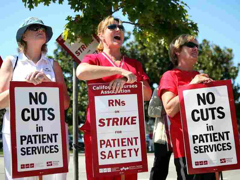 Registered nurses hold signs as they strike outside of the Mills-Peninsula hospital on Sept. 22, 2011 in Burlingame, California. Tens of thousands of registered nurses held a strike at more than thirty hospitals to protest proposed cuts to benefits.