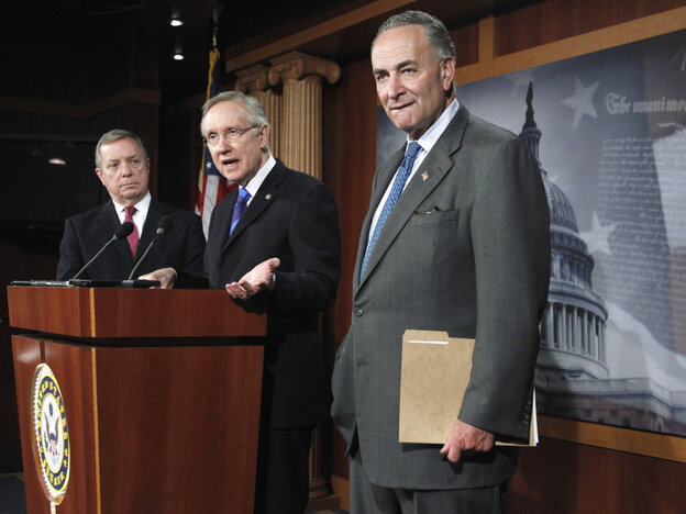 Senate Majority Leader Harry Reid unveils his surtax proposal flanked by Sens. Richard Durbin (l) and Charles Schumer, Oct. 5, 2011.