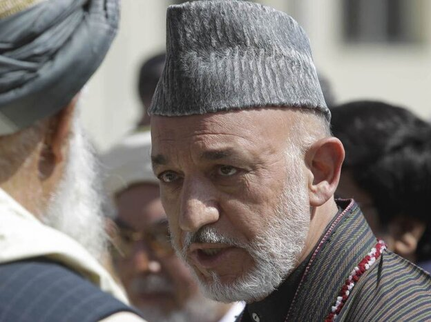 Afghan President Hamid Karzai at the funeral ceremony of slain Afghanistan High Peace Council and former president Burhanuddin Rabbani on Sept. 23, 2011.