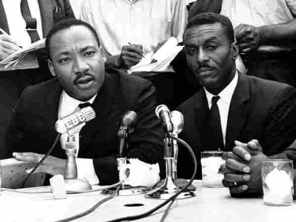 Civil rights leaders Rev. Martin Luther King Jr., left, Rev. Fred Shuttlesworth, center, and Rev. Ralph Abernathy hold a news conference in Birmingham, Ala., in this May 8, 1963 file photo. Shuttlesworth, who was hailed by the Rev. Martin Luther King Jr. for his courage and energy, died Wednesday, Oct. 5.