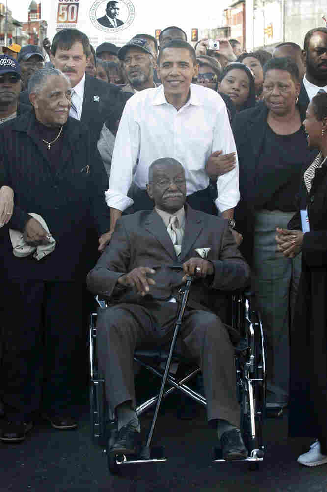 "In this file photo from 2007, Sen. Barack Obama pushes civil rights activist Rev. Fred Shuttlesworth during a commemoration of the 1965 ""Bloody Sunday"" Voting Rights march in Selma, Ala. Shuttlesworth died Wednesday, at age 89."