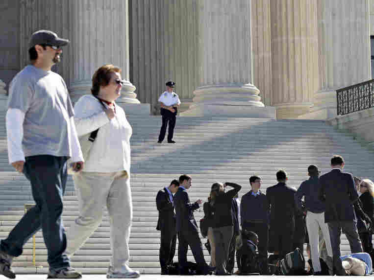 As visitors lined up outside the Supreme Court on Wednesday, the justices grappled with the question of when churches might be exempt from certain federal laws.