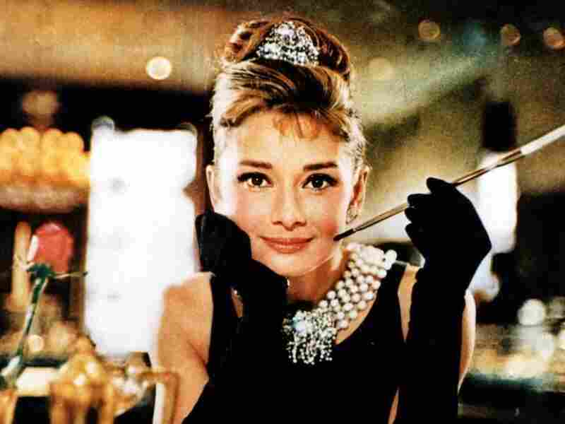 This photo released by Christie's auction house shows actress Audrey Hepburn in the 1961 film, Breakfast at Tiffany's. The black Givenchy dress worn by Hepburn sold at auction for $807,000.