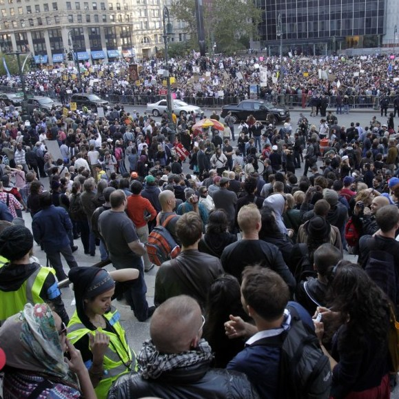 Occupy Wall Street protesters join a labor union rally in New York's Foley Square on Wednesday.