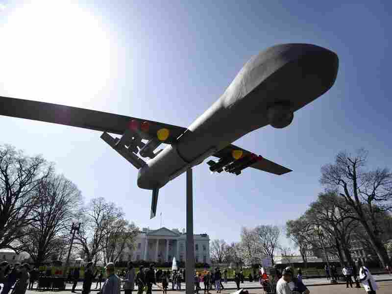 Anti-war protesters displays an effigy of a attack drone as they take part in a demonstration in front of the White House in Washington, DC, on March 19, 2011.