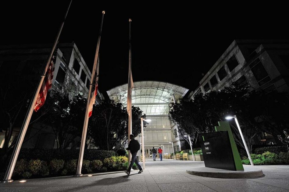 Flags fly at half staff after the death of Steve Jobs at the Apple headquarters in Cupertino, Calif.  (Getty Images)