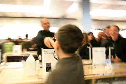 Alan shaking Steve Jobs' hand.