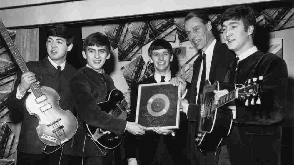 The Beatles, left to right: Paul McCartney, George Harrison, Ringo Starr, producer George Martin, John Lennon.