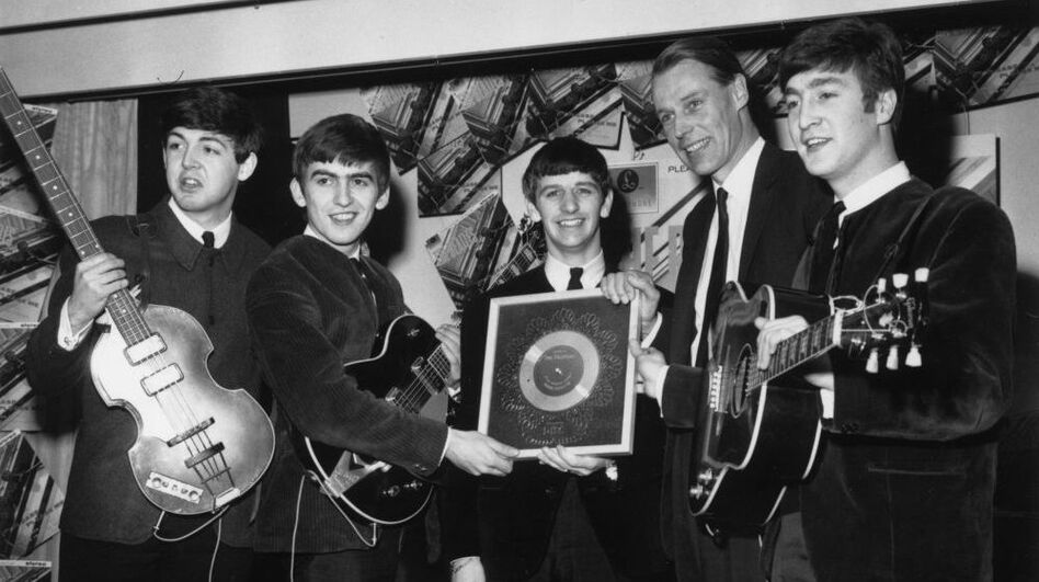 The Beatles, left to right: Paul McCartney, George Harrison, Ringo Starr, producer George Martin, John Lennon. (Getty Images)