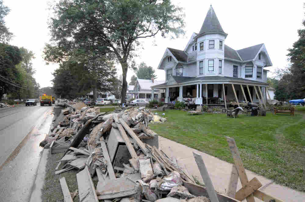 Streets in Schoharie, N.Y., are lined with storm debris and damaged furniture after Tropical Storm Irene hit in late August. Like dozens of counties across the country, Schoharie faces high costs to repair its infrastructure, putting a strain on FEMA's budget.