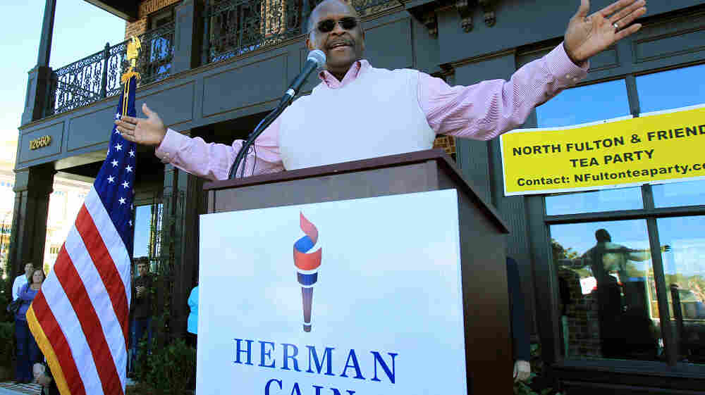 Republican presidential candidate and former Godfather's Pizza CEO Herman Cain, fresh off a surprising win in Florida's straw poll, speaks to supporters as he campaigns and launches his new book in Milton, Ga., earlier this month.