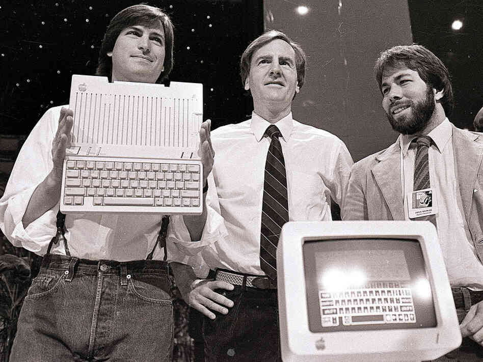 April 24, 1984, from left to right: Steve Jobs, John Sculley and Steve Wozniak unveil the new Apple IIc computer in San Francisco.