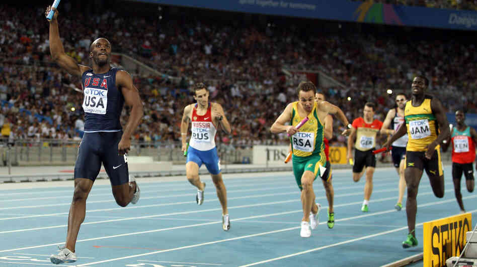 LaShawn Merritt crosses the finish line first, in the men's 4x400-meter r