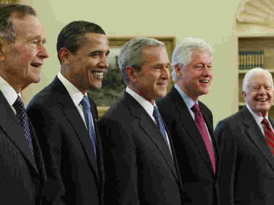 Obama is surrounded by former presidents in the Oval Office in 2009. Two of his predecessors — George W. Bush and Bill Clinton — won two terms, while two others — George H.W. Bush and Jimmy Carter — left office after just one.
