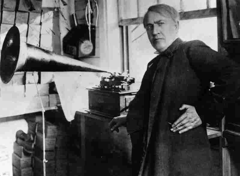 Thomas Alva Edison:  Transformed American industry and culture by inventing the phonograph and the motion picture camera and developing a long-lasting electric light bulb. Known as the Wizard of Menlo Park, Edison also founded General Electric. In this photo from 1877, Edison stands with the phonograph.