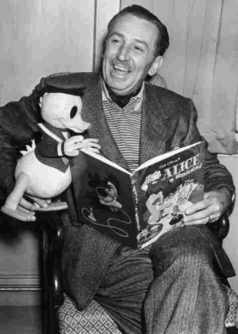 Walt Disney:  Revolutionized animation and inspired iconic characters, stories and Walt Disney Co. theme parks that have become a permanent fixture in popular culture. Disney posed with a Donald Duck character while reading from Alice in Wonderland during a 1951 movie premiere in London.