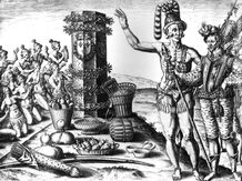 A line drawing depicts indigenous Americans making an offering of cacao beans and other foods before an altar while a conquistador looks on. Both the Mayans and Aztecs cultivated cacao.