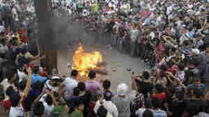 Protesters opposed to Syrian President Bashar Assad burn an effigy of him during Friday prayers in Tripoli, Lebanon.
