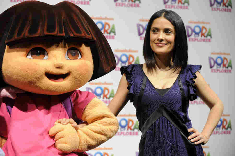 """Movie star Salma Hayek poses with """"Dora the Explorer"""" during a 10th anniversary event last year. Dora, voiced by Caitlin Sanchez, is only one of the most recent Latino stars in a long history of Latinos on television."""