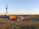 An oil drilling rig near Stanley, North Dakota. The well is being drilled into the Bakken Formation, one of the largest contiguous deposits of oil and natural gas in the United States.