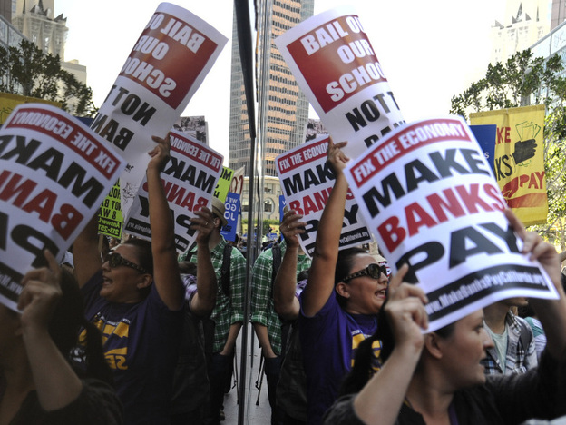 <p>The Occupy Wall Street movement has spread to Washington, D.C., Los Angeles and other cities. In L.A. Thursday, protesters gathered outside a Wells Fargo downtown, above, and at a Bank of America branch where some were arrested for trying to protest inside. </p>