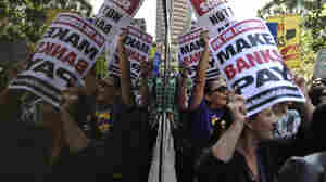 The Occupy Wall Street movement has spread to Washington, D.C., Los Angeles and other cities. In L.A. Thursday, protesters gathered outside a Wells Fargo downtown, above, and at a Bank of America branch where some were arrested for trying to protest inside.