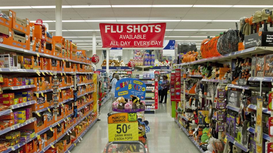 Three years ago, drugstores like Walgreens began training pharmacists to give customers vaccines. Since then, tens of thousands of pharmacists have been certified to give shots. (Francis Ying for Kaiser Health News/NPR)