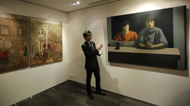 These two paintings were up for auction in Hong Kong in February. Art auctions produce eye-popping sales figures in China, though critics say there is a widespread problem with fakes.