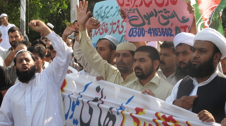 <p>Protesters rally in support of Mumtaz Qadri, who was sentenced to death for the murder of Gov. Salman Taseer. Qadri appealed his sentence Thursday.</p>