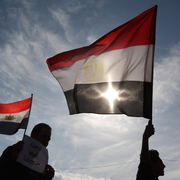 Jan. 30, 2011: Men in Cairo's Tahrir Square hold Egyptian flags.