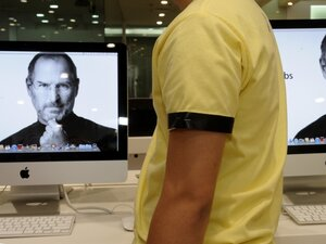 A sales clerk at an Apple store in Manila wears a black arm band to mourn the death of Apple co-founder and chairman Steve Jobs on Oct. 7, 2011.