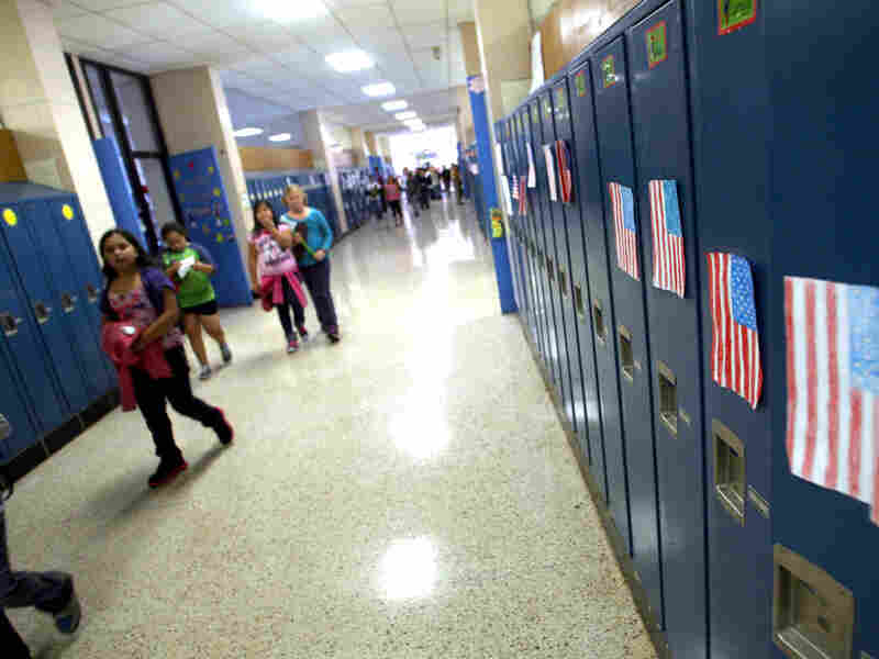 Students walk through the hallways of West Liberty Elementary School. Schools in the town were the first in the state to offer dual-language programs.