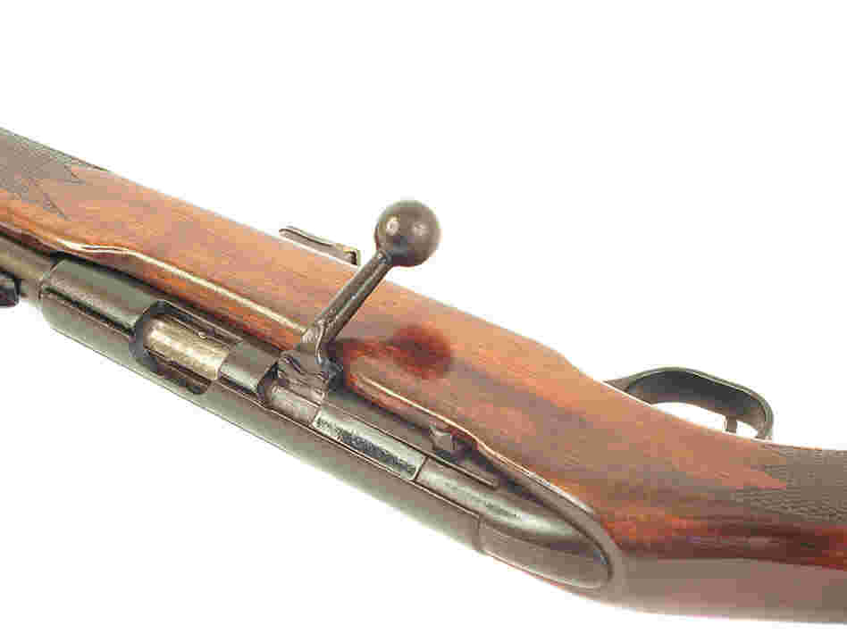 Bolt-action rifle.