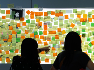 Messages posted on a glass window pay tribute to the late Apple co-founder Steve Jobs outside the Apple store in Hong Kong.